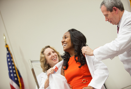 A first-year medical student receives her white coat