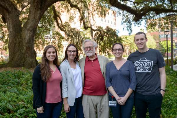 Nora Awadallah, Casey Keuthan, Peter Walter, Ph.D., Heather Drew and John Calise pose for a group shot after the students organized a reception for Walter in the George T. Harrell, M.D., Medical Education Building.