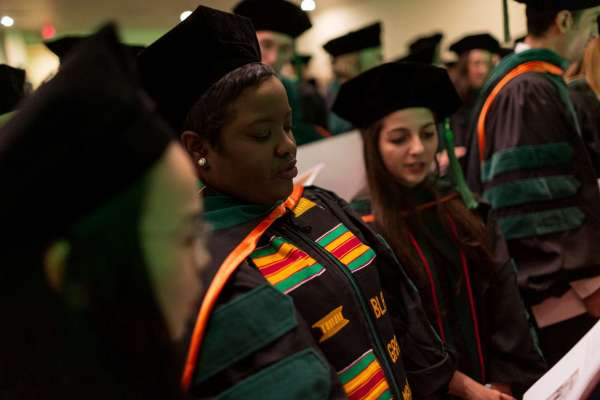 Students recite the Hippocratic Oath at commencement
