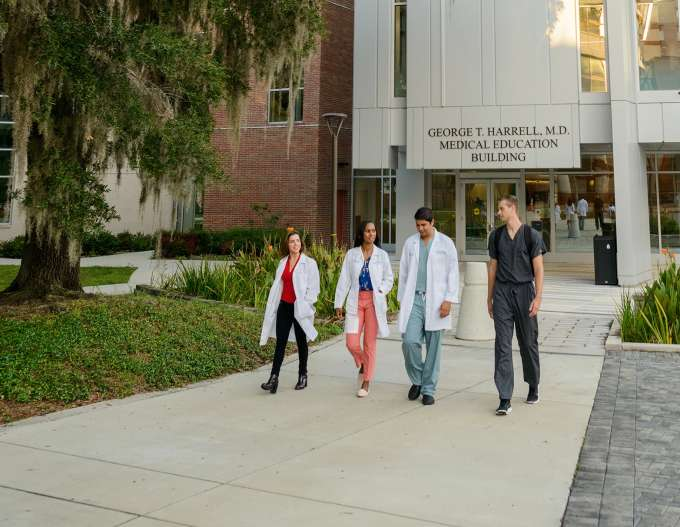 Medical Students walking near The Harrell Medical Education building