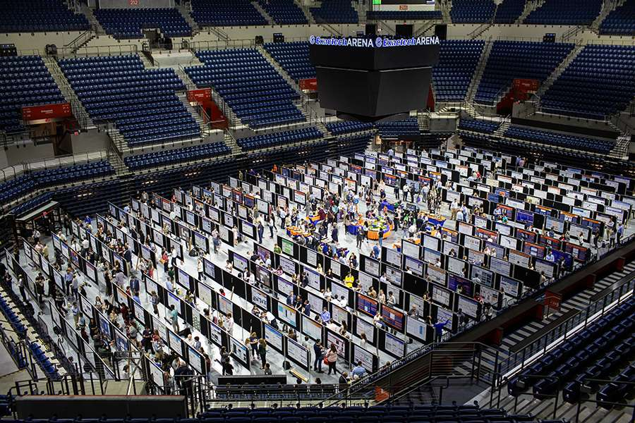Aerial photo of research posters on display throughout the O'Connell Center arena.