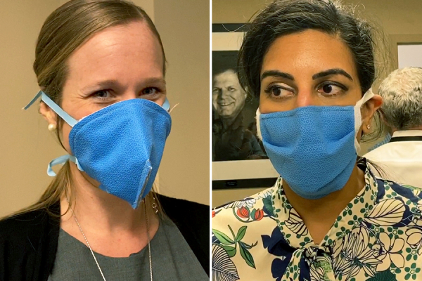 Two UF Health workers demonstrate mask prototypes that are crafting masks out of materials already available in medical facilities.