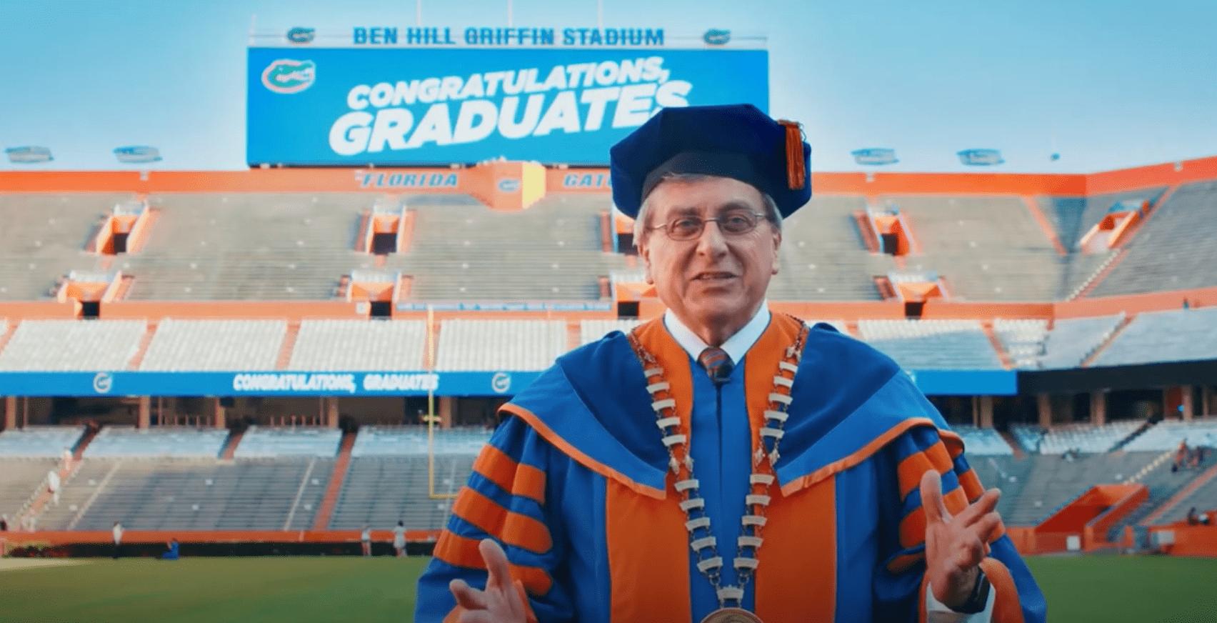 President Fuchs wears graduation attire in Ben Hill Griffin Stadium