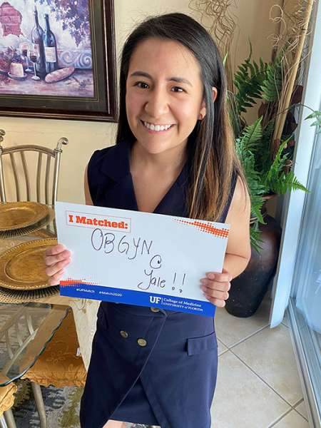 XIomara Brioso Rubio holds a sign announcing where she matched for residency training.