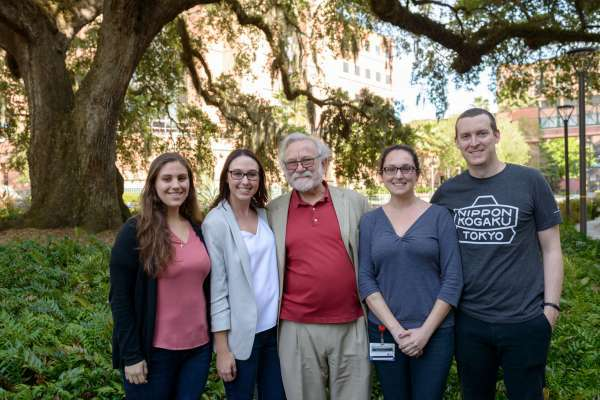 Nora Awadallah, Casey Keuthan, Peter Walter, P-H-D, Heather Drew and John Calise pose for a group shot after the students organized a reception for Walter in the George T. Harrell, M.D., Medical Education Building.