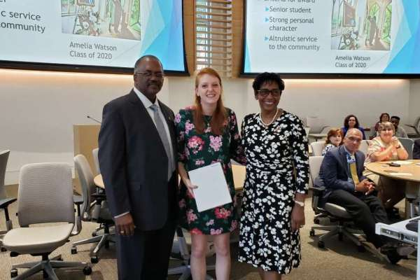 Amelia Watson, center, is presented with the Caroline Annette Cody, M.D., Memorial Scholarship, by Dr. William and Betty Cody.