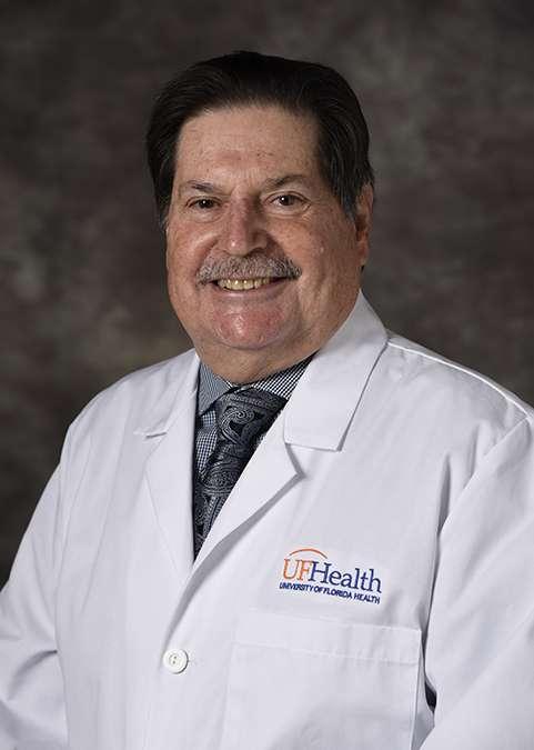 Paul Hoffman wearing a white U-F Health lab coat.