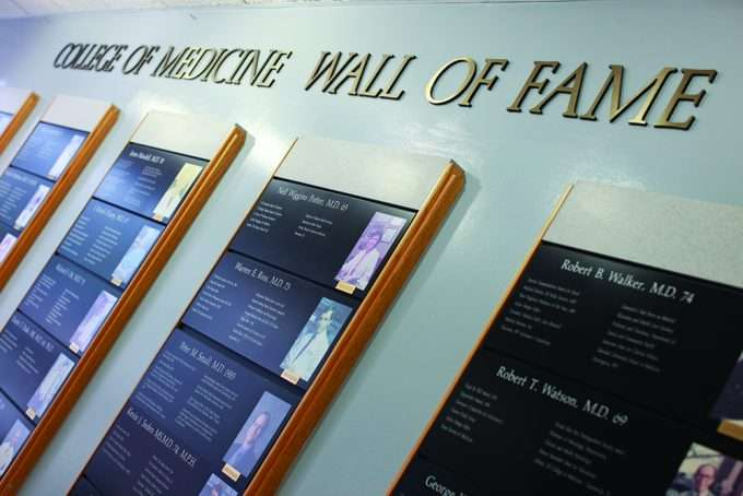 College of Medicine Wall of Fame plaques along a wall.