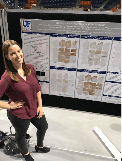 Emily Koller stands in front of her research poster