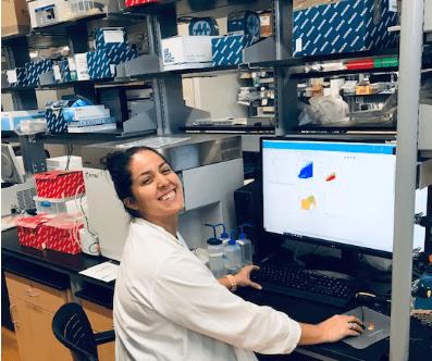 Ashley Zuniga at a computer in a lab.