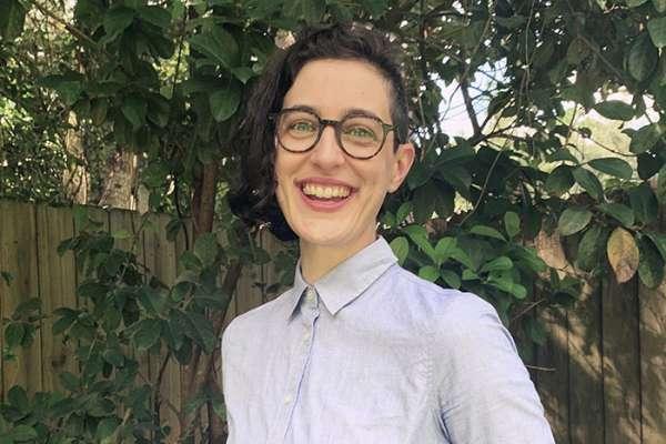 Kristen Skruber smiles while standing outdoors.