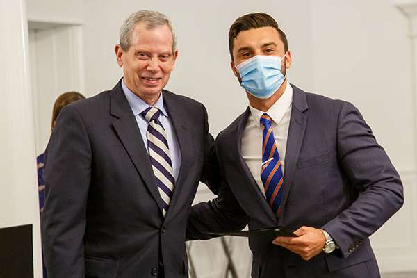 A student poses for a photo with Doctor Duff.