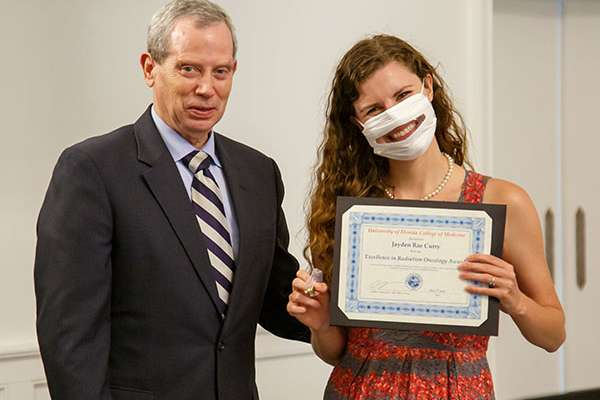 Student Jayden Curry poses for a photo with Doctor Duff.