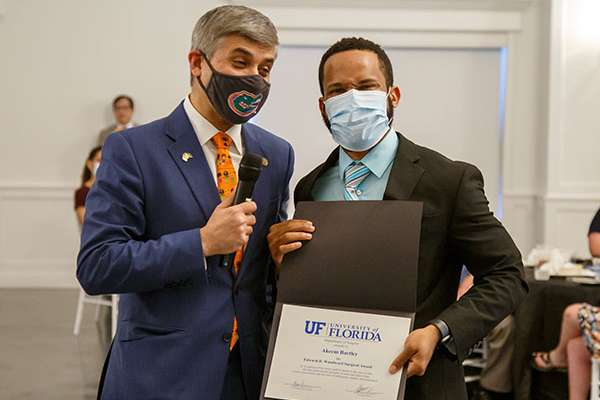 Student Akeem Bartley poses for a photo with Doctor Saleem.