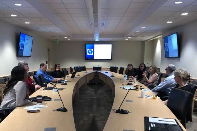 Faculty gather in a conference room.