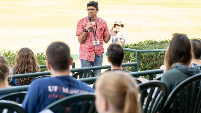 Michael Lauzardo speaks to a crowd outdoors.